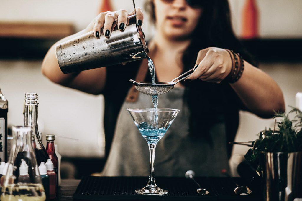 Bartender making a blue martini